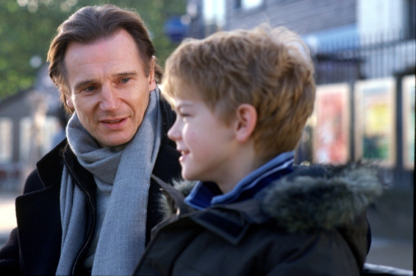 Sam (THOMAS SANGSTER) opens up to his stepfather Daniel (LIAM NEESON) in Richard Curtis? romantic comedy movie Love Actually. 	Photo Credit: Peter Mountain. ©2003 Universal Studios.